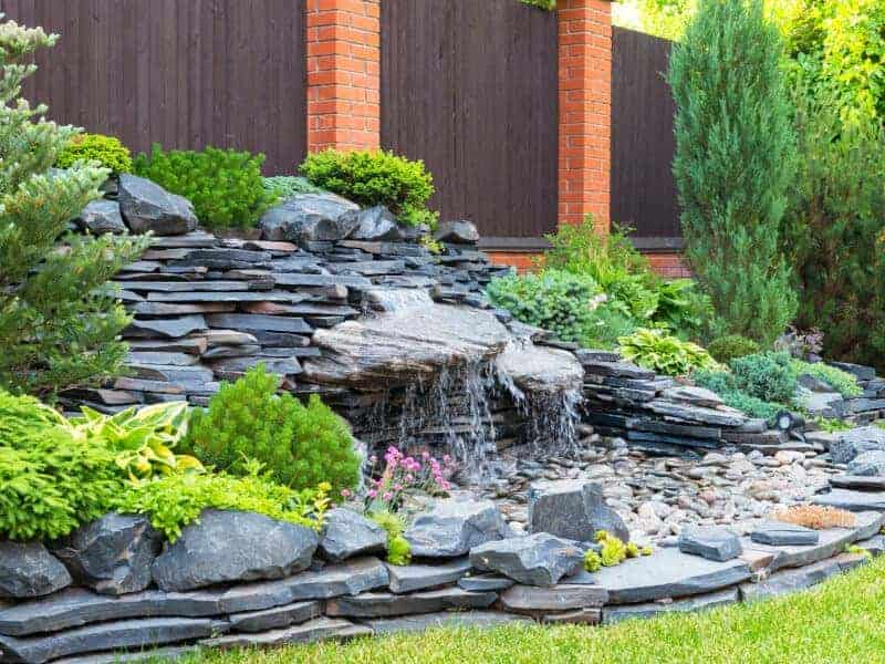 pondless waterfall dripping through pebbles from slate rock no basin