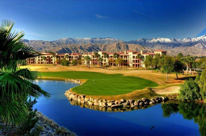 desert community association lake on golf course with mountains